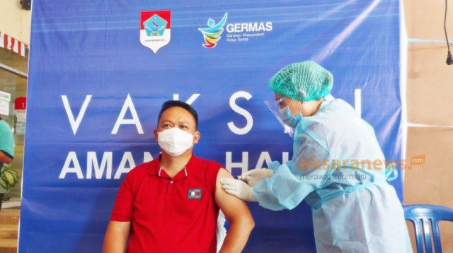 Medy Lensun Jadi yang Pertama Lakukan Penyuntikan Vaksin Covid-19 di Boltim